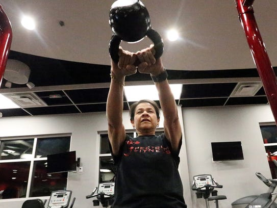Melissa Ontiveros-Chavez swings a kettle weight while