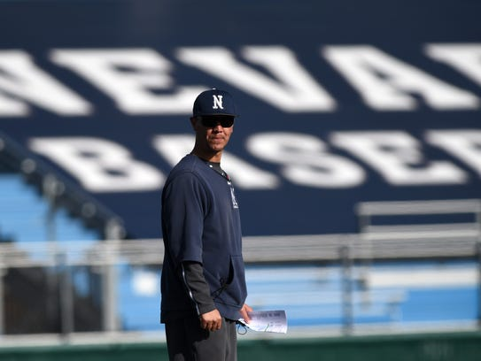 Nevada baseball coach T.J. Bruce stands on the field