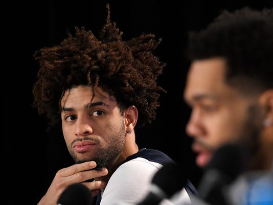 Gonzaga guard Josh Perkins, left, listens as guard Silas Melson speaks during a news conference at the NCAA men's college basketball tournament, Wednesday, March 21, 2018, in Los Angeles. Gonzaga faces Florida State in a regional semifinal on Thursday. (AP Photo/Mark J. Terrill)