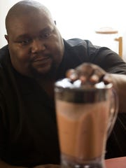Rev. William Enoch McCoy makes himself a protein shake