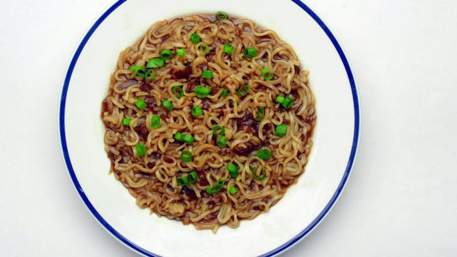 """Ramen noodles plus a can of beer plus a can of onion soup equals """"Beer Noodles,"""" one of the recipes from the book """"101 Things To Do With Ramen Noodles"""" by Toni Patrick, published in 2005,"""