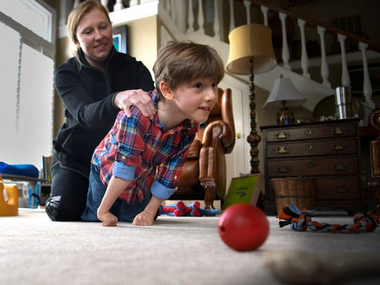 Stefanie Dean Brown works with her son Dean 7, who  has cerebral palsy at their home Saturday, April 21, 2018, in Nashville, Tenn.