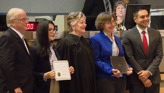 Gill Sorg, Yvonne Flores, Judge Mary Rosner, Joy Goldbaum and Gabriel Vasquez pose for a picture after Rosner swore them into office. Monday Nov. 20, 2017.