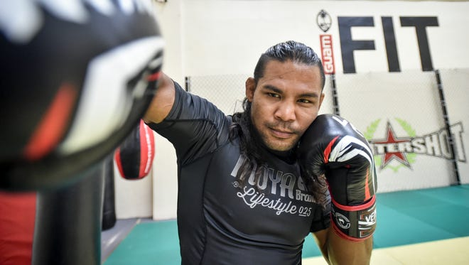 "Professional mixed marital artist Baby Joe ""The Juggernaut"" Tamianglo, 31, from Talofofo, throws a right hook at the iFit gym in Tamuning on Aug. 5."