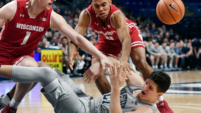 Penn State forward John Harrar falls to the floor during the game against Wisconsin on Monday night.