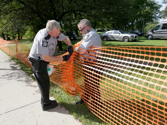 Milwaukee County sheriff's deputies work on putting