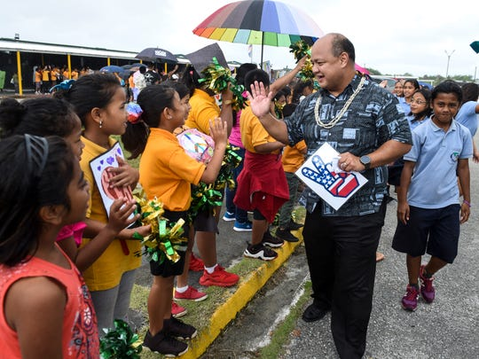 Guam Department of Education Superintendent Jon Fernandez is greeted by Maria A. Ulloa Elementary students during a Peace March, by the Vicente S.A. Benavente Middle School student and faculty members and others, through the streets of Dededo on Thursday, Feb. 22, 2018.