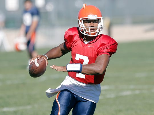 UTEP quarterback Kavika Johnson rolls out looking for a receiver at Camp Ruidoso. He will be the starting quarterback against the Texas Longhorns.