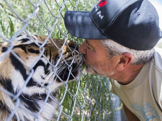 Keepers of the Wild founder Jonathan Kraft kisses Sheena, a Bengal tiger, in Valentine, AZ, May 27, 2015. The a nonprofit sanctuary for retired Las Vegas show tigers and other exotic animals is looking to expand north of Kingman.