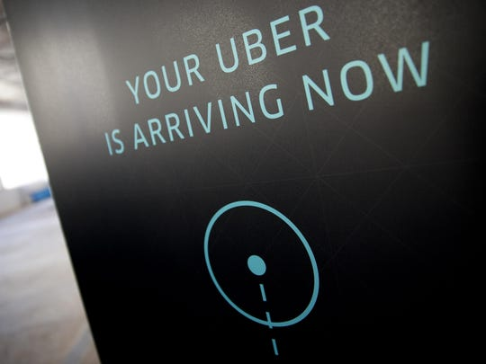 To do well offering services through outfits such as Airbnb or Uber, you must treat it like a business. Uber signage stands inside the company's office in Washington, D.C., in this file photo.