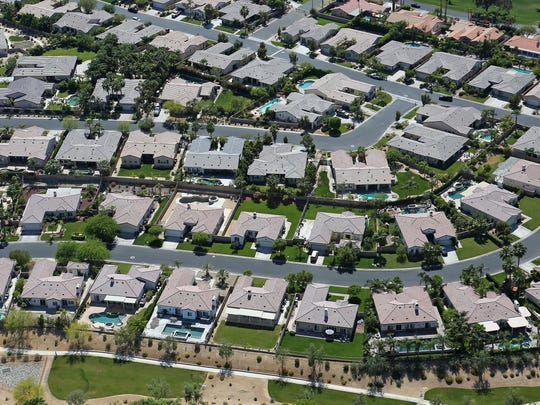 Green lawns surround homes at Heritage Palms Golf Club in Indio.