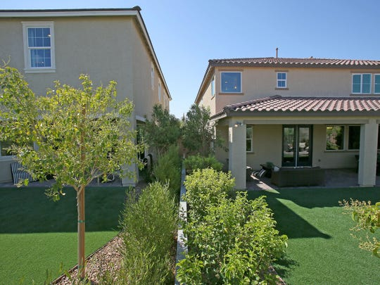 Some homes at the master-planned Inspirada community in Henderson, Nevada, have artificial grass and drought-tolerant landscaping in their backyards.