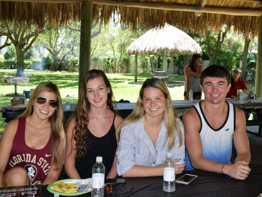 Seniors Haley Havemeier, Megan Maguire, Taylor Lowdermilk and Cole Stretton are seen at the pre-grad picnic.