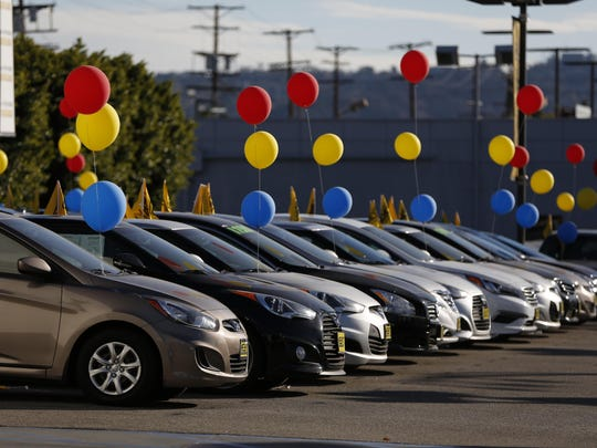 Vehicles sit on display for sale on the lot of the Keyes Hyundai dealership in Los Angeles, California, on Saturday, Jan. 2, 2016.