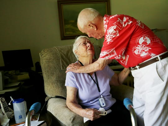 Paul Smith, 95, comforts his wife, Viola, 94, in their East Naples home on Monday as he recalls serving during the Pearl Harbor attack.