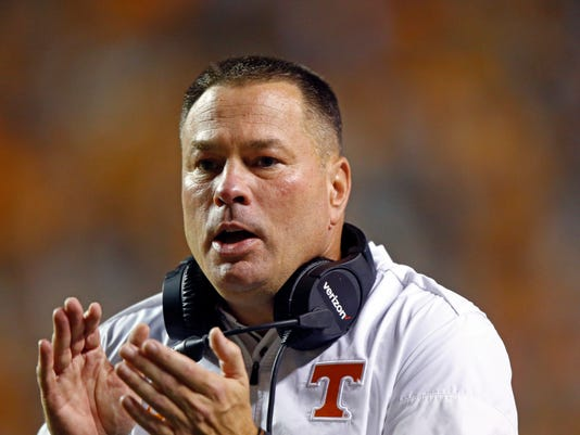 FILE - In a Saturday, Nov. 4, 2017 file photo, Tennessee head coach Butch Jones is seen on the sideline in the first half of an NCAA college football game against Southern Mississippi, in Knoxville, Tenn. Tennessee has fired coach Butch Jones with two games left in a regular season in which the Volunteers started ranked but are now still winless in the Southeastern Conference. Vols athletic director John Currie said Sunday, Nov. 12, 2017, that he has asked Jones to step down as head football coach. (AP Photo/Wade Payne)