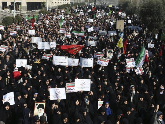 Iranian protesters chant slogans at a rally in Tehran, Iran, Dec. 30. Iranian hard-liners rallied to support the country's supreme leader.