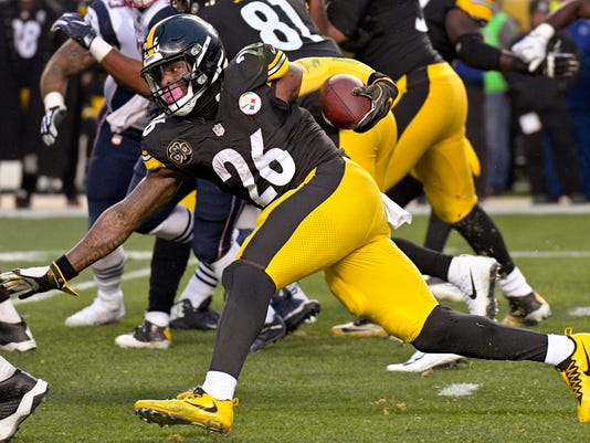 FILE - This file photo from Dec. 17, 2017, Pittsburgh Steelers running back Le'Veon Bell (26) as he runs the ball against the New England Patriots during the first half of an NFL football game in Pittsburgh. The running back is fresh heading into Sunday's playoff game against Jacksonville. Bell only had 15 carries in the teams' first meeting this season. (AP Photo/Don Wright, FILE)