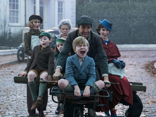 Jane (Emily Mortimer, left), John (Nathanael Saleh), Annabel (Pixie Davies), Ellen (Julie Walters). Jack (Lin-Manuel Miranda) Georgie (Joel Dawson) and Mary Poppins (Emily Blunt) are joyriding and singing in the musical sequel 'Mary Poppins Returns' (Dec. 19), based on the popular series of eight children's books from P.L. Travers.