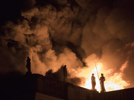 In this Sept. 2, 2018 file photo, flames engulf the 200-year-old National Museum of Brazil, in Rio de Janeiro.