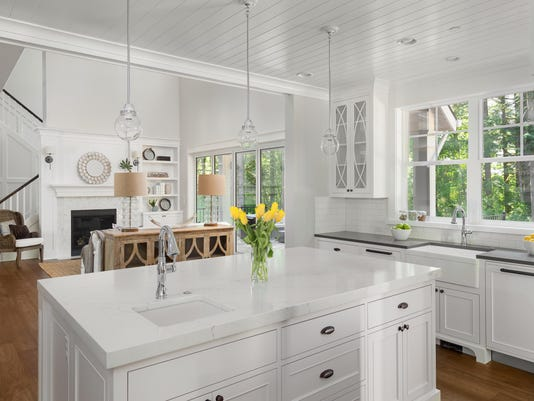 White kitchen Interior and living room in luxury home