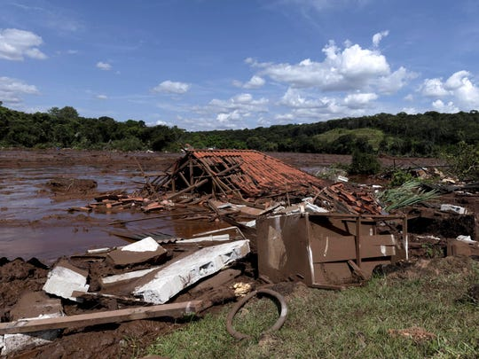 A home lays in ruins after a dam collapsed near Brumadinho, Brazil, Friday, Jan. 25, 2019.
