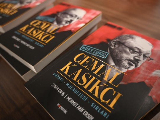 Books dedicated to the murdered the Saudi journalist Jamal Khashoggi, written by his partner Hatice Cengiz, are displayed during a presentation in Istanbul on February 8, 2019.