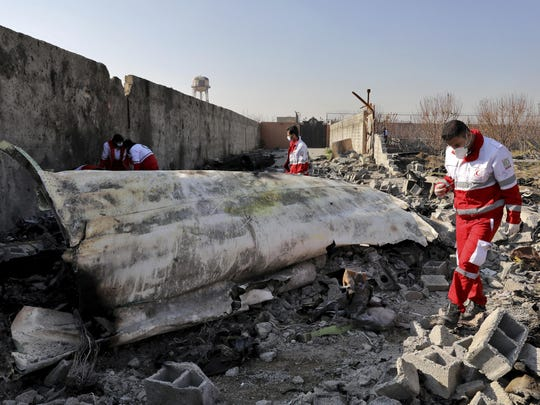 "In this Wednesday, Jan. 8, 2020 photo, rescue workers search the scene where a Ukrainian plane crashed in Shahedshahr, southwest of the capital Tehran, Iran. Iran on Saturday acknowledged that its armed forces ""unintentionally"" shot down the Ukrainian jetliner that crashed earlier this week, killing all 176 aboard, after the government had repeatedly denied Western accusations that it was responsible. (AP Photo/Ebrahim Noroozi)"