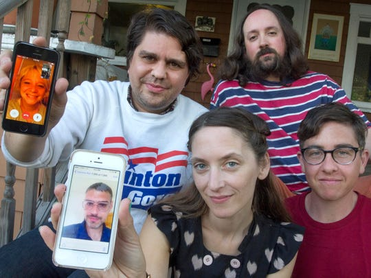 Band members of The Smittens, left to right, back row (including phone), Missy Bly, David Zacharis, Colin Clary and left to right, front row (including phone), Max Andrucki, Holly Chagnon, Dana Kaplan, in Burlington on Monday.
