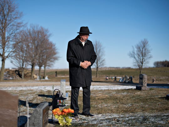 Henry Rayhons visits the grave marker of his late second wife Donna Young, at a cemetery in Garner on Nov. 25. Rayhons is awaiting trial on a felony charge that he raped his late wife Donna Young at a nursing home where she was living.
