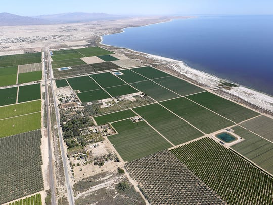 Farmland and Highway 111 run along the Salton Sea's northern shore.