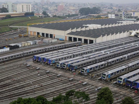 Metro trains sit parked on the second day of a strike by the operators in Sao Paulo, Brazil, Friday, June 6, 2014. Overland commuter train operators went on strike Thursday, stranding the millions of people who use Sao Paulo's public transport systems. (AP Photo/Nelson Antoine)