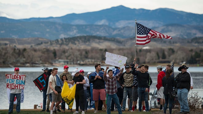 Students supporting gun rights demonstrate March 23 in Loveland as a counter-protest to students calling for more limits on guns in the wake of school shootings.