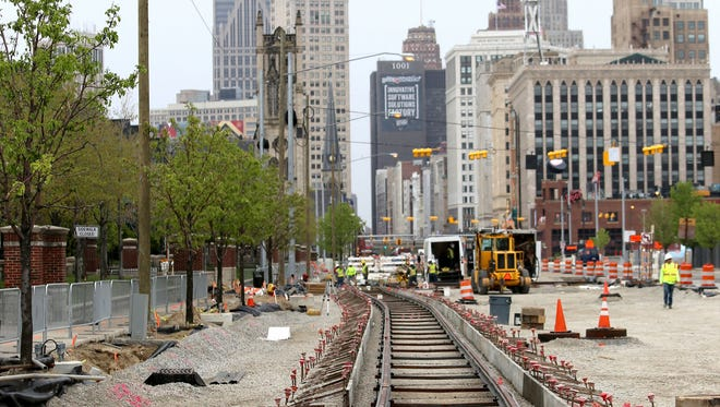 In May 2016, new rail lines were being installed near Adelaide and Woodward in Detroit for the new street car rail system to be known as the QLINE.