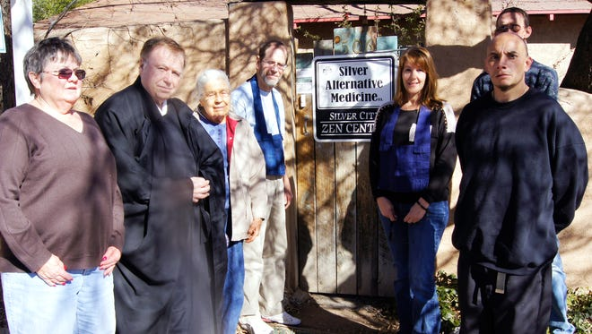 Members of the Silver City Zen Center gather on Saturday at the center, which is located on 13th Street across from WNMU. The Rev. Dr. Paul Stuetzer, second from left, is the center's resident priest.