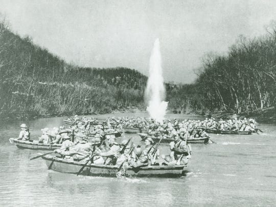 Explosive charges enhance the realism of the 6th Infantry's Sabine River crossing in August 1941.