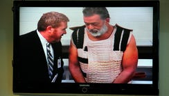 Robert Dear, right, appears via video before Judge