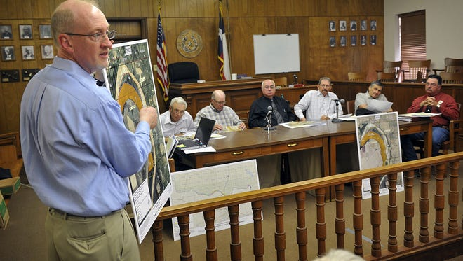 Bureau of Land Management Field Manager Steve Tryon uses a map during a presentation at the Clay County Commissioners' Court in Henrietta on May 27, 2014. A settlement is in the works between BLM and landowners. It was approved by Wichita County Monday morning.