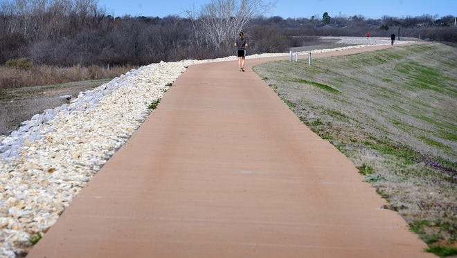A popular section of the Circle Trail runs along the dam at Lake Wichita from the spillway to Lake Wichita Park.