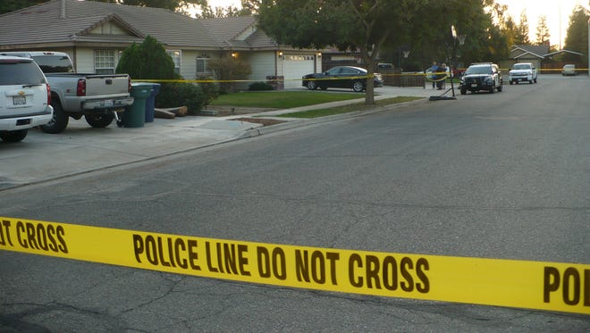 Police yellow tape posted in the 200 block of East Garfield Avenue where police responded to investigate a homicide Wednesday.
