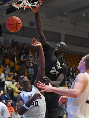 UCF Knights center Tacko Fall (24) dunks over George Washington Colonials forward Kevin Marfo (40) during the second half at Charles E. Smith Center Thursday, Dec. 15.