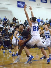 Robert E. Lee's Isaiah Elliston posts up against Spotswood's