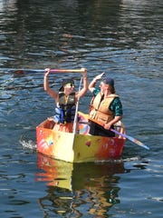 Brittany Hunt and Olivia MacDonald, both of Sturgeon Bay, celebrate a successful paddle in last year's Sikaflex Challenge boat building and sea trials competition.