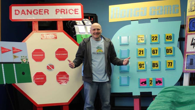 """Timothy Chappa, Youth Go program supervisor and recreation coordinator, shows off his """"The Price is Right"""" game creations."""