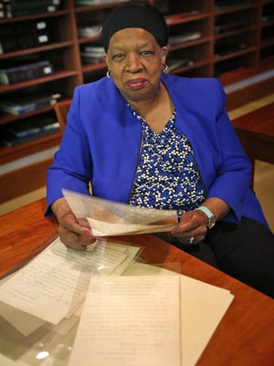 Wilma Moore, senior archivist of African-American History at the Indiana Historical Society, shows letters from IPS 17 students written to Irven Armstrong in 1918 when he was a World War I soldier. Armstrong had been a teacher at IPS 17, which was next to Attucks High School.