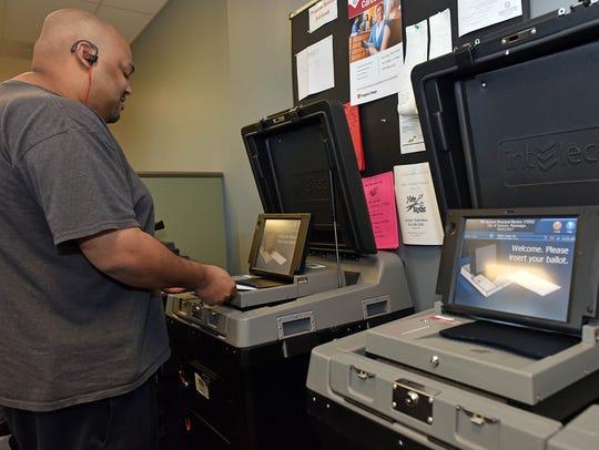 Jackson resident Genoa Campbell votes at Precinct 79