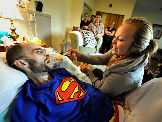 Caleb Hanby accepts sherbet from his wife, Bethany,