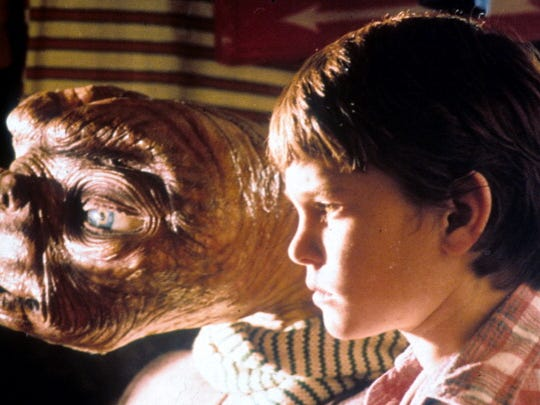 ET looking out window with Henry Thomas in a scene from the film 'E.T. The Extra-Terrestrial', 1982. (Photo by Universal/Getty Images)