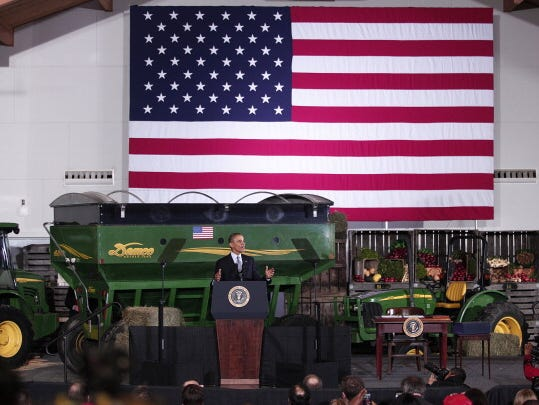 U.S. President Barack Obama speaks about the Farm Bill, or the the Agriculture Act of 2014, Feb. 7, in East Lansing, Mich. Obama signed the largely bipartisan legislation that reforms the farm insurance program and trims food stamps by 1 percent.