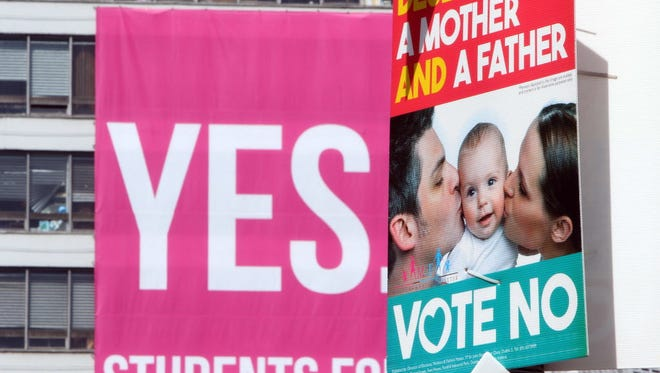 Banners encouraging voters to support the Yes and the No campaigns in the Irish same-sex marriage referendum are seen in Dublin on May 13.